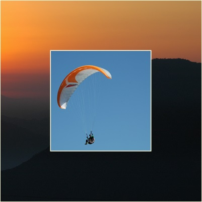 person using parachute with blue sky behind them