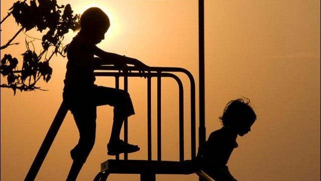 silhouette-of-children-on-a-slide_thumb